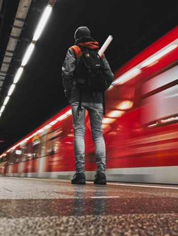low angle photography of person standing on subway station